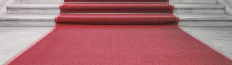 A red carpet on a marble staircase
